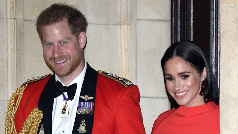 Meghan Markle stuns in red cape dress with Prince Harry at The Mountbatten Festival Of Music