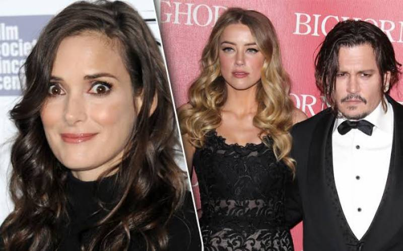 Winona Ryder doesn't believe ex Johnny Depp can be violent towards Amber Heard
