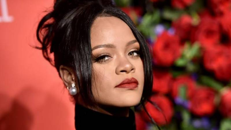 No new music as Rihanna too busy 'trying to save the world'