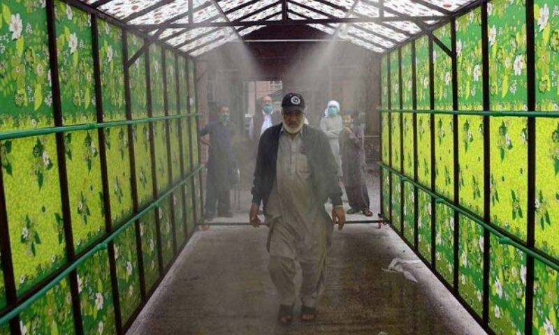 Coronavirus: Human sanitizing tunnel installed at Nishtar Hospital