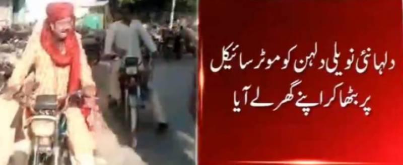 Groom takes bride on motorbike in Karachi amid coronavirus lockdown
