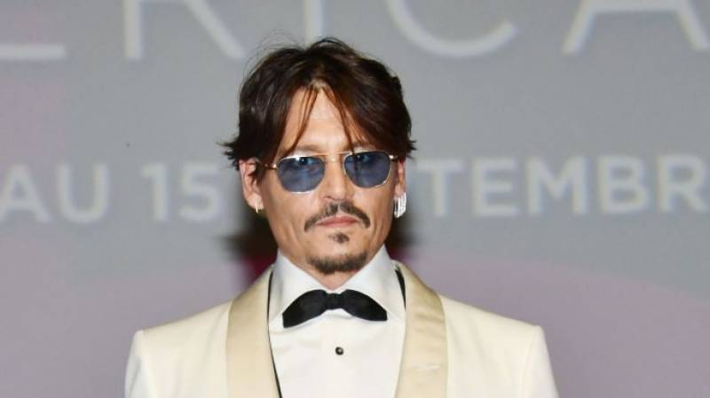 Johnny Depp claims tabloids hacked into his phone