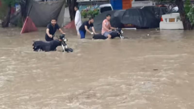 Rain claims five lives in Karachi, floods roads, localities