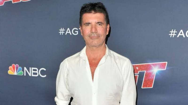 Simon Cowell in hospital after breaking his back