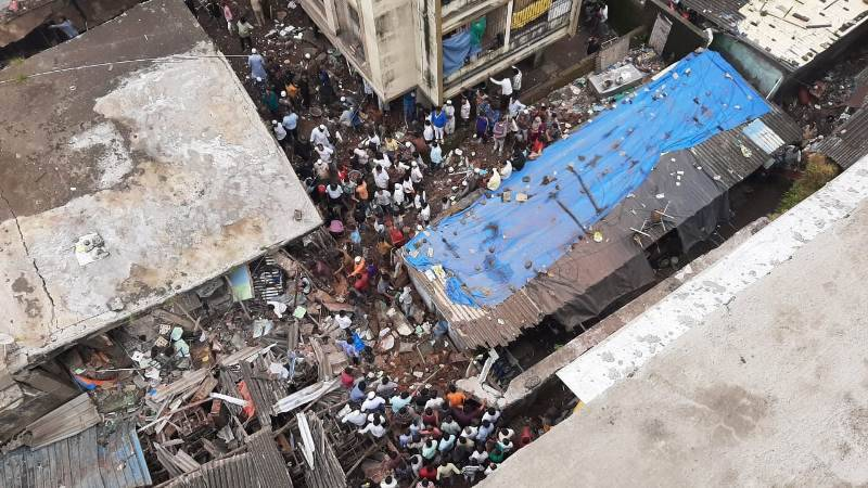 10 dead, 35 feared trapped in India's Bhiwandi city building collapse