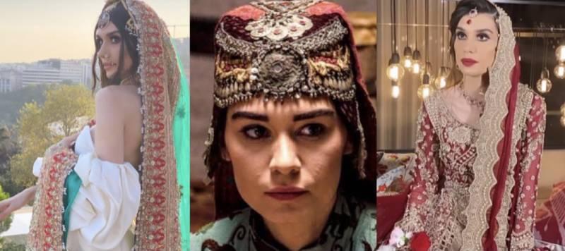 'Ertuğrul' star Burcu Kıratlı looks ravishing in a red ensemble by Pakistani designer