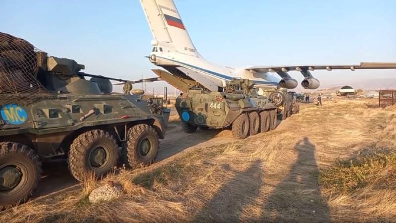 Russia deploys first peacekeeper troops in Nagorno-Karabakh as Armenia surrenders to Azerbaijan