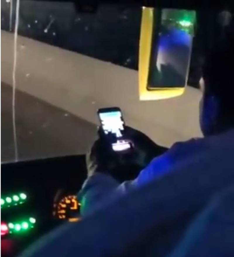Bus driver plays mobile phone game behind the wheel