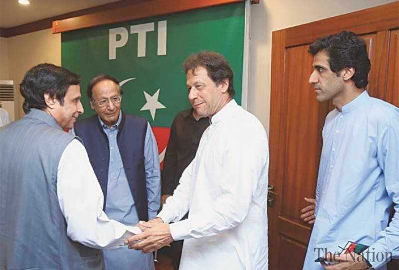 PM Imran woos back Chaudhry brothers during Lahore visit