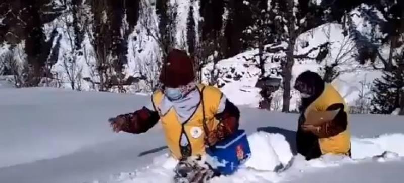 Video of Pakistani women vaccinators wading through waist-deep snow goes viral