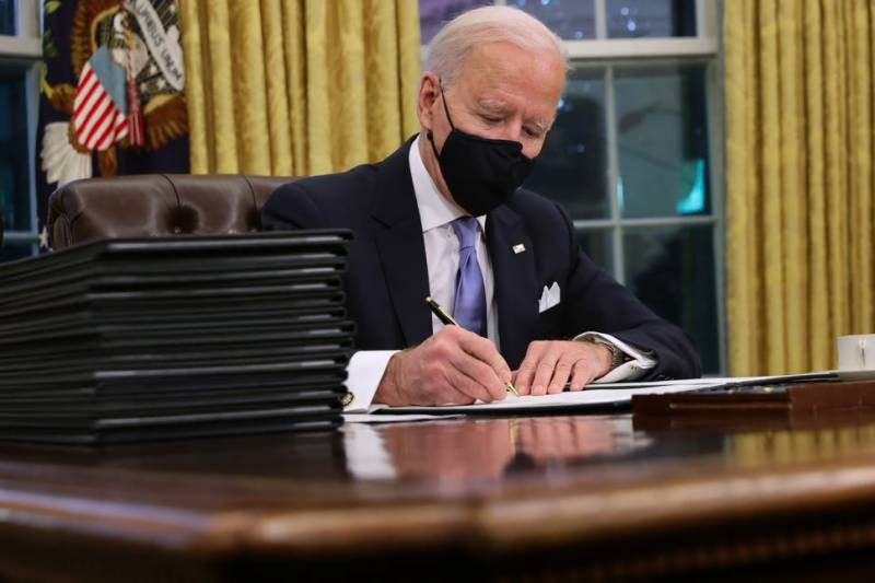 No time to waste: Biden rolls back Trump policies on wall, climate, health, Muslims