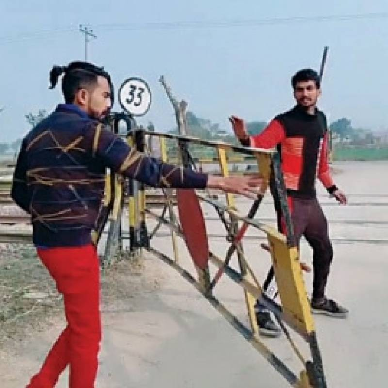 Two TikTokers arrested for filming clips on level crossing in Lahore