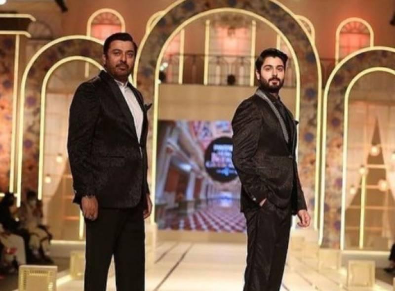 Naumaan Ijaz walks the ramp with son Zaviyar at the BCW