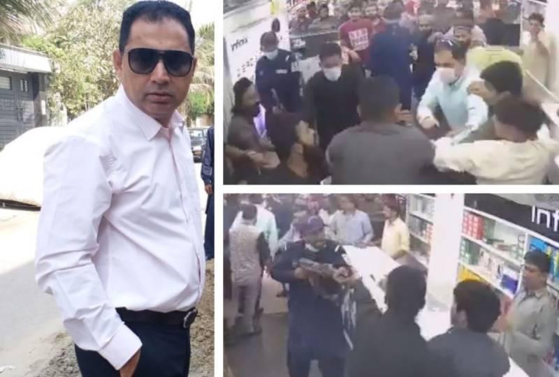 WATCH - PTI MNA Aslam Khan, guards beat up Karachi mobile shop owner