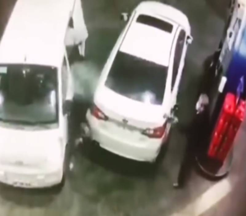 Watch: Filling station worker douses 'robbers' with fuel