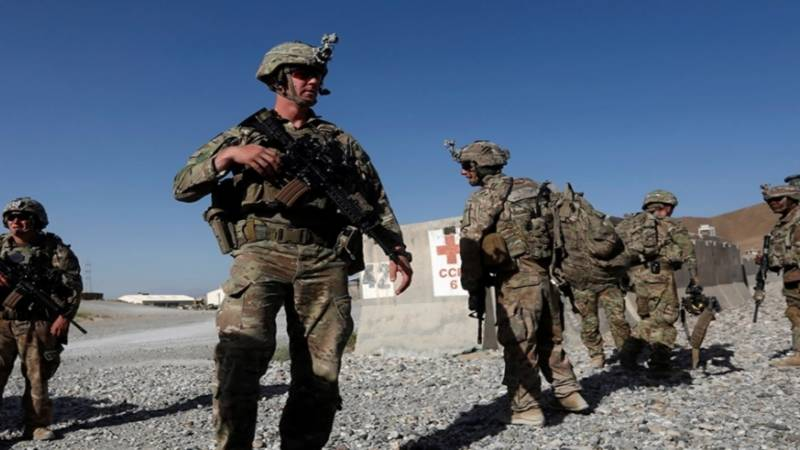Taliban warns against NATO troops staying beyond withdrawal deadline