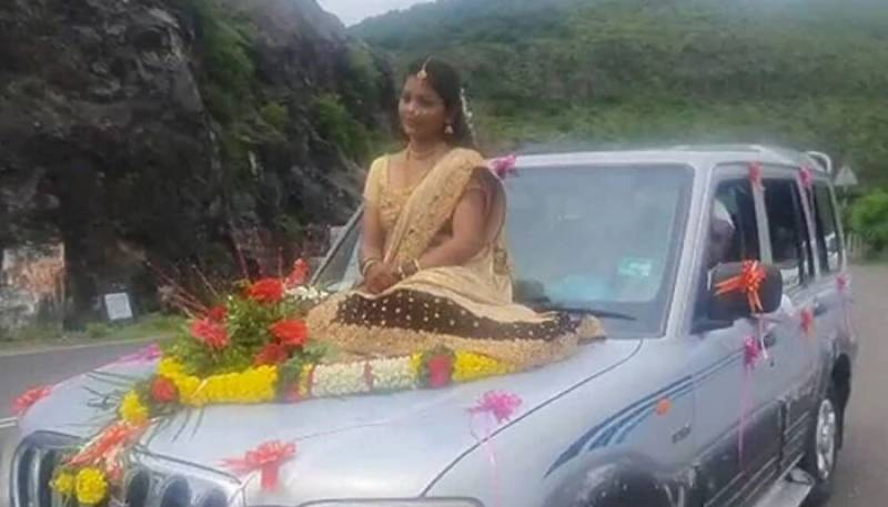 WATCH: Indian bride who travelled to wedding venue on car bonnet booked for violating Covid norms