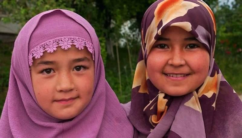 Uzbekistan allows schoolgirls to wear headscarves to woo devout Muslim families