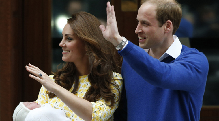 Britain's Prince William, right, and Kate, Duchess of Cambridge, pose for the media with their newborn daughter outside St. Mary's Hospital's exclusive Lindo Wing, London, Saturday, May 2, 2015. The Duchess gave birth to the Princess on Saturday morning. (AP Photo/Alastair Grant)