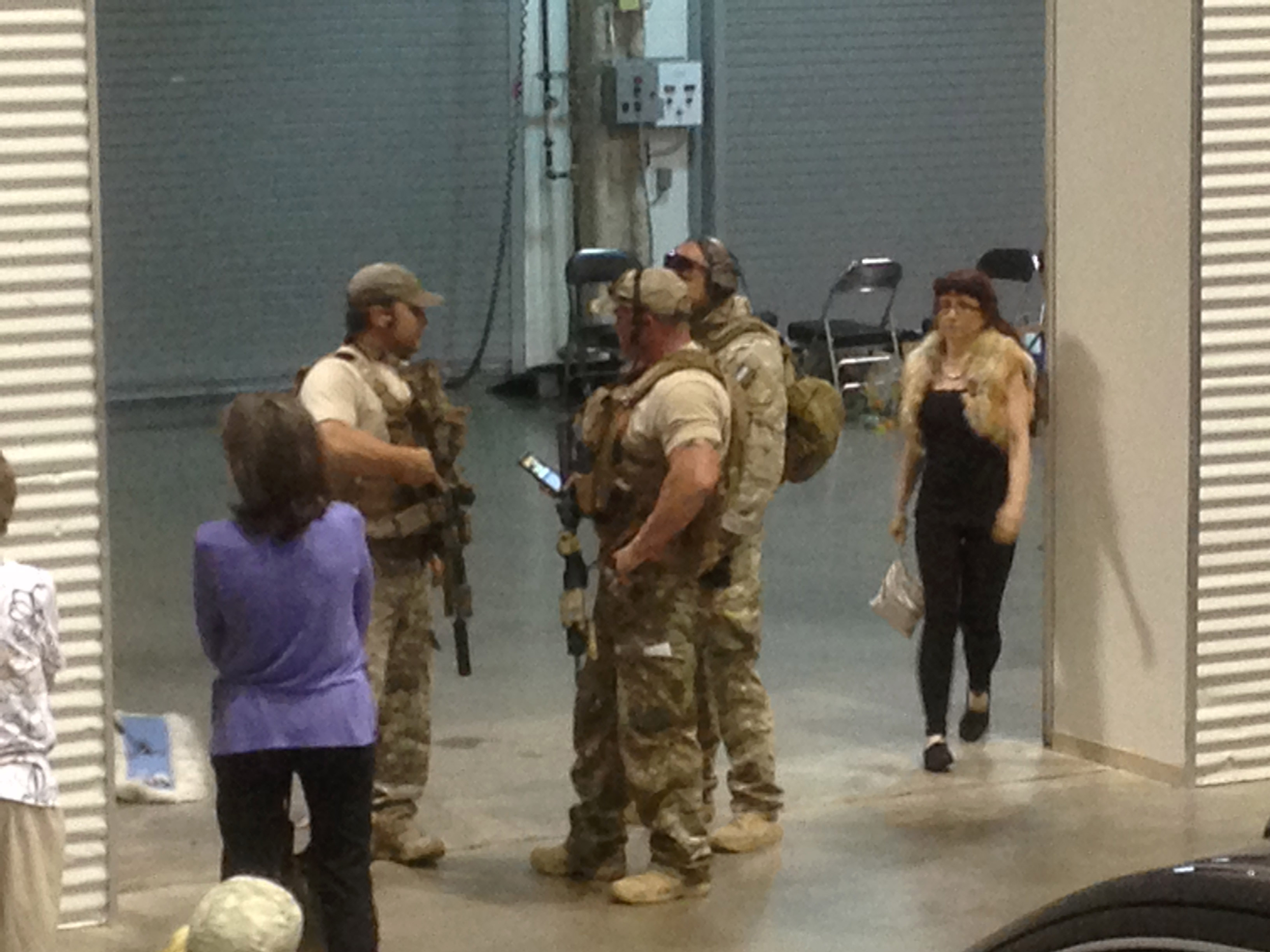Members of the Garland Police Department stand inside the Curtis Culwell Center, Sunday, May 3, 2015, in Garland, Texas. A contest for cartoons depictions of the Prophet Muhammad in the Dallas suburb is on lockdown Sunday after authorities reported a shooting outside the building. (AP Photo Nomaan Merchant)