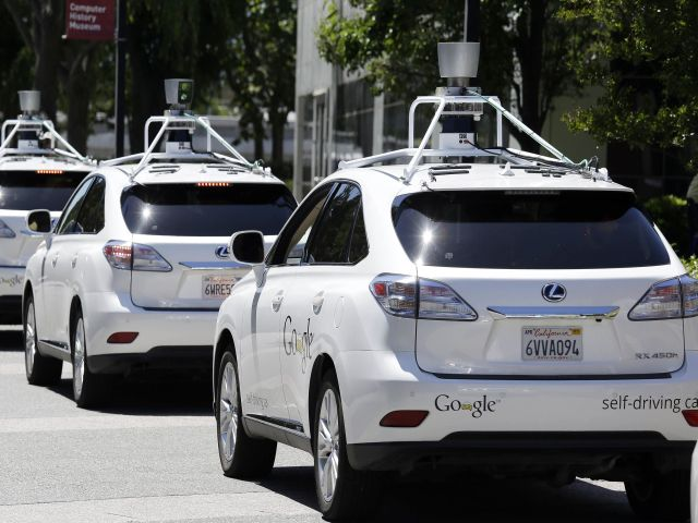 FILE - This May 13, 2014 file photo shows a row of Google self-driving Lexus cars at a Google event outside the Computer History Museum in Mountain View, Calif. Of the nearly 50 self-driving cars rolling around California roads and highways, four have gotten into accidents since September, 2014. That's when the state officially began permitting these cars of the future, which use sensors and computing power to maneuver around traffic. Three accidents involved souped-up Lexus SUVs run by Google Inc. The fourth was an Audi retrofitted by the parts supplier Delphi Automotive. Google and Delphi said the accidents were minor and their cars were not at fault.(AP Photo/Eric Risberg, File)