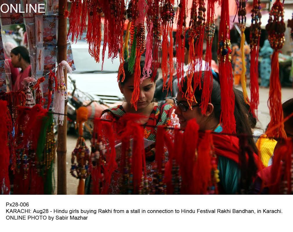 Px28-006KARACHI: Aug28 - Hindu girls buying Rakhi from a stall in connection to Hindu Festival Rakhi Bandhan, in Karachi.ONLINE PHOTO by Sabir Mazhar