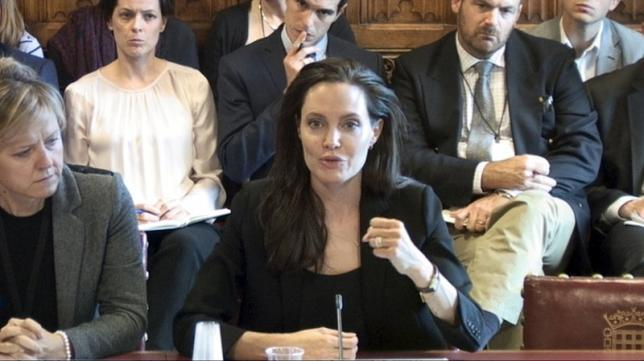 U.N.H.C.R. Special Envoy Angelina Jolie Pitt gives evidence to the House of Lords ad hoc Committee considering the UK's policy and practice of preventing sexual violence in conflict, in the Houses of Parliament in Westminster, London, in this image taken from a September 8, 2015 handout video by Parliament TV. REUTERS/Parliament TV/Handout via Reuters