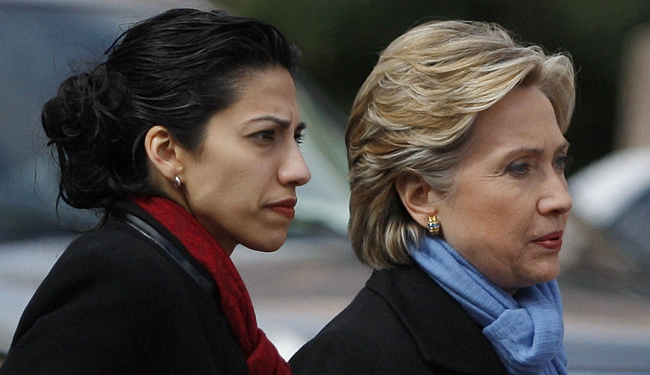 US Democratic presidential candidate Senator Hillary Clinton (D-NY) (R) walks with her traveling chief-of-staff Huma Abedin as they approach a group of police officers after cancelling a rally in Fort Worth, Texas February 22, 2008. A Dallas police officer was killed Friday when his motorcycle struck a pillar as he was escorting democratic presidential candidate Senator Clinton to a rally in Dallas. Clinton cancelled the rally in Forth Worth, saying it would be inappropriate to hold a rally in light of the tragic circumstances. REUTERS/Jessica Rinaldi (UNITED STATES) US PRESIDENTIAL ELECTION CAMPAIGN 2008 (USA) - RTR1XFP4