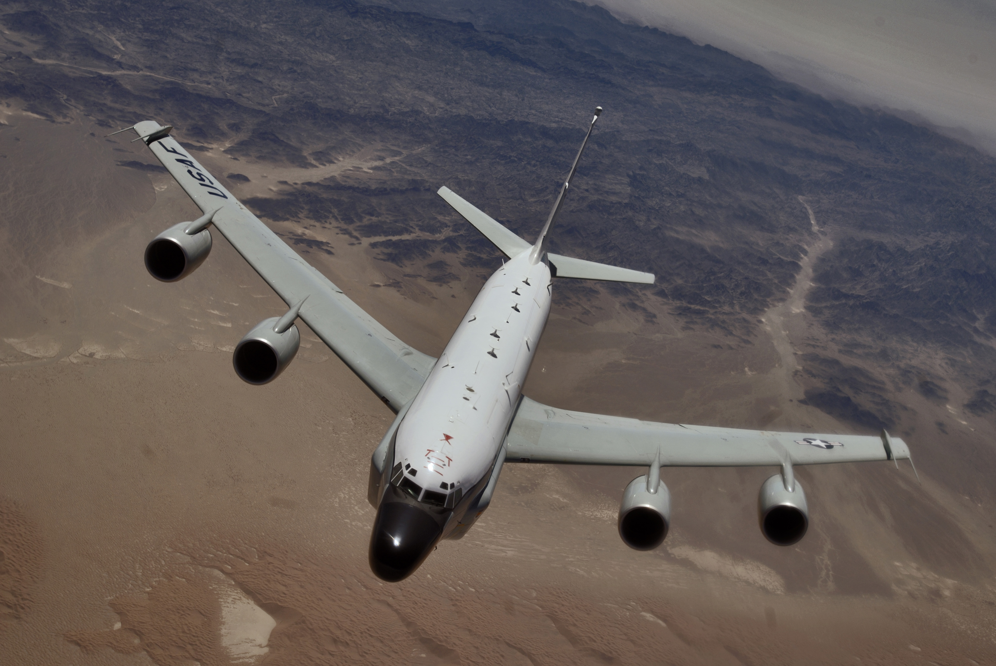RC-135 Rivet Joint reconnaissance aircraft moves into position behind a KC-135T/R Stratotanker for an aerial refueling at a speed greater than 250 knots over Southwest Asia. When connected to the refueling boom, the aircraft will receive more than 40,000 pounds of fuel allowing it to remain on station or move on to other stations to perform its mission. The RC-135 flightcrew of Capt. Mike Edmondson, pilot; 1st Lt. Erik Todoroff, copilot; and 1st Lt. Chris Young, navigator are deployed to the 763rd Expeditionary Reconnaissance Squadron, in Southwest Asia, from 343rd Reconnaissance Squadron, Offutt Air Force Base, Neb. They are natives of East Moline, Il., Jackson, Mich., and Charleston S.C.. (U.S. Air Force photo by Master Sgt. Lance Cheung)