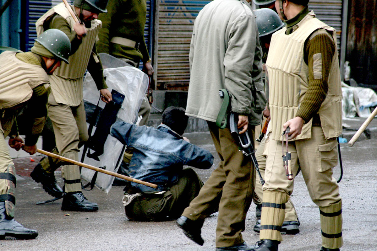 27March 2009. Kashmiri protester being beaten by Indian security forces with a brick and bamboo sticks as they detain him during a protest in Srinagar.