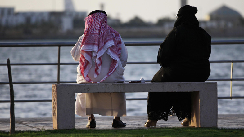 In this Sunday, May 11, 2014 photo, a Saudi couple sit on a bench overlooking the sea, in Jiddah, Saudi Arabia. A growing number of Saudi women are remaining single through their 20s and into their 30s as they pursue their ambitions, sending ultraconservatives into a panic. Traditionally, women in Saudi Arabia are expected to be married by their early twenties. Women are also challenging the rules on how to meet a prospective husband. (AP Photo/Hasan Jamali)