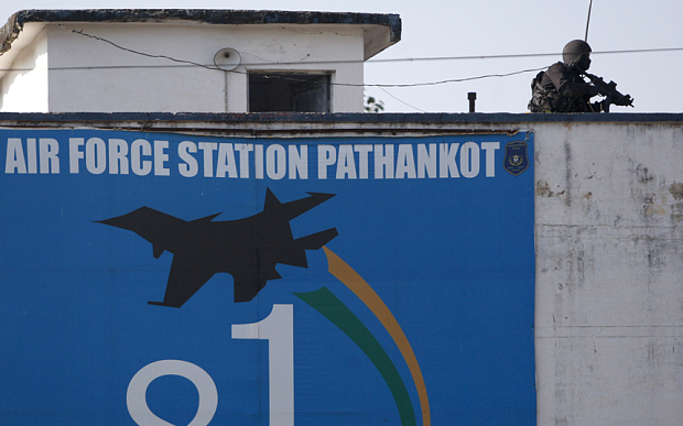 An Indian military commando is seen on the top of a building at the Indian air force base in Pathankot, India, Tuesday, Jan.5, 2016. Indian forces have killed the last of the six militants who attacked the air force base near the Pakistan border over the weekend, the defense minister said Tuesday, though soldiers were still searching the base as a precaution. (AP Photo/Channi Anand)