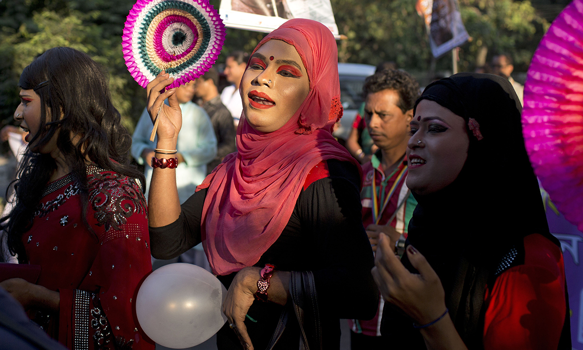 Members of Bangladesh's transgender community and their supporters participate in a pride rally to mark one year since the government recognized them as a third gender in Dhaka, Bangladesh, Monday, Nov. 10, 2014. (AP Photo/A.M. Ahad)