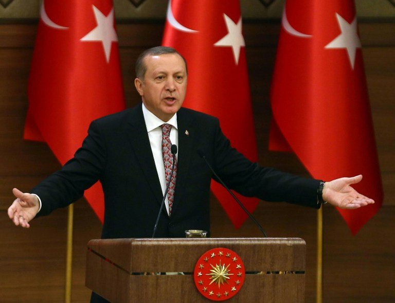 Turkey's Recep Tayyip Erdogan delivers a speech during the monthly Mukhtars meeting (local administrators) at the Presidential Complex in Ankara on February 10, 2016. Turkish President Recep Tayyip Erdogan on February 10 accused the United States of creating a