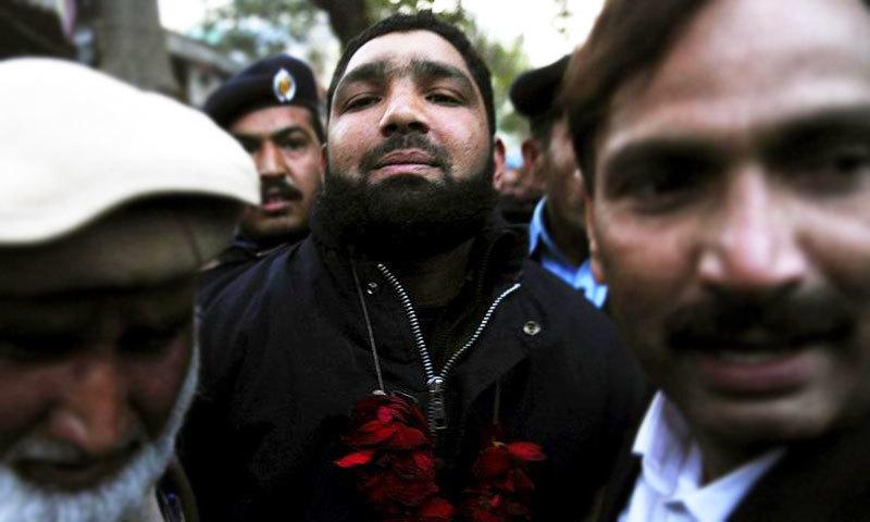 Malik Mumtaz Qadri in police custody.