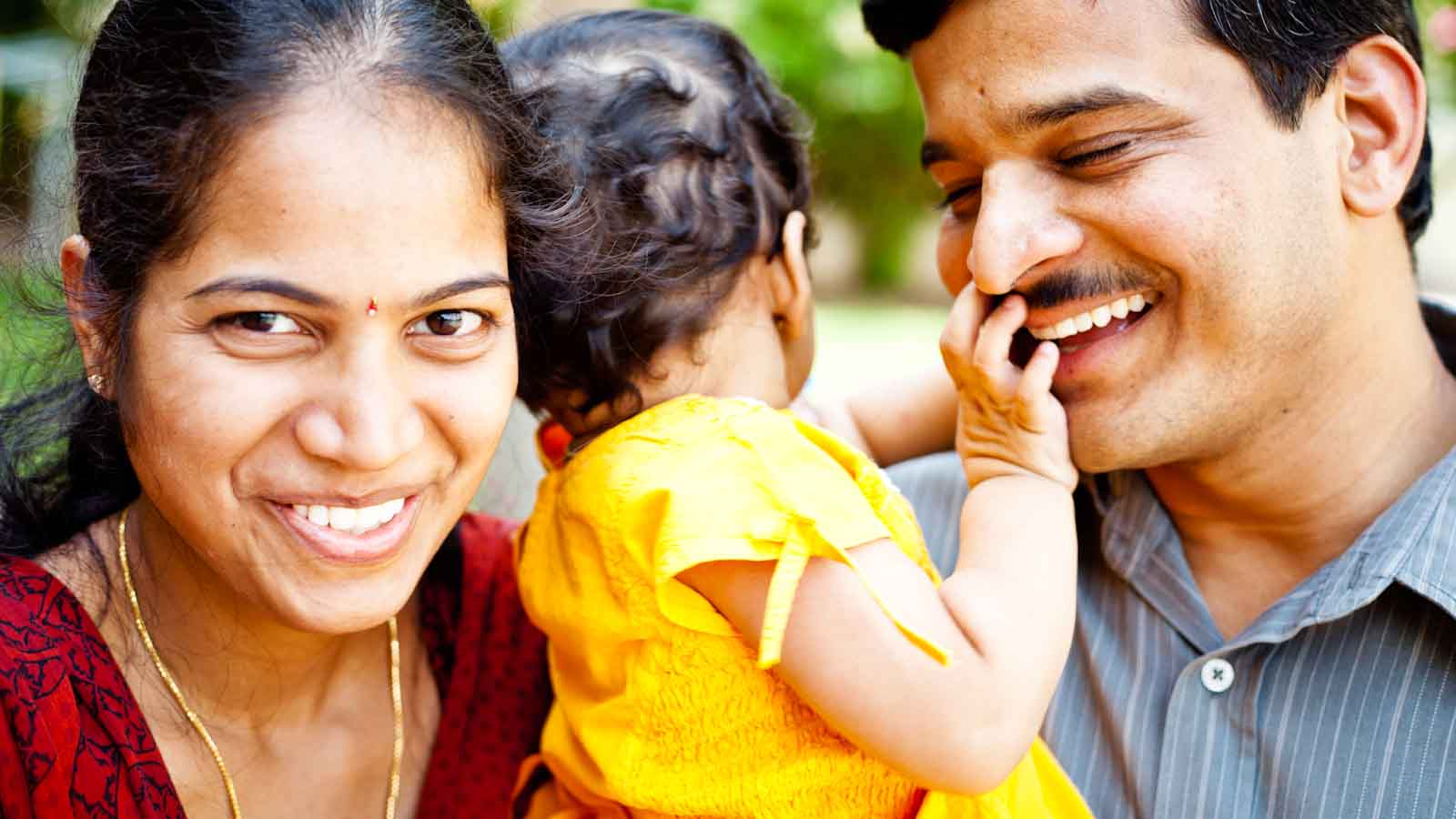 Happy Indian Family of three Cheerful Young Couple (Soft Image)