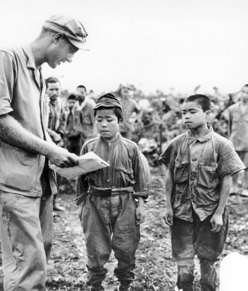 a-us-marine-attempts-to-communicate-with-japanese-child-soldiers-photo-u1