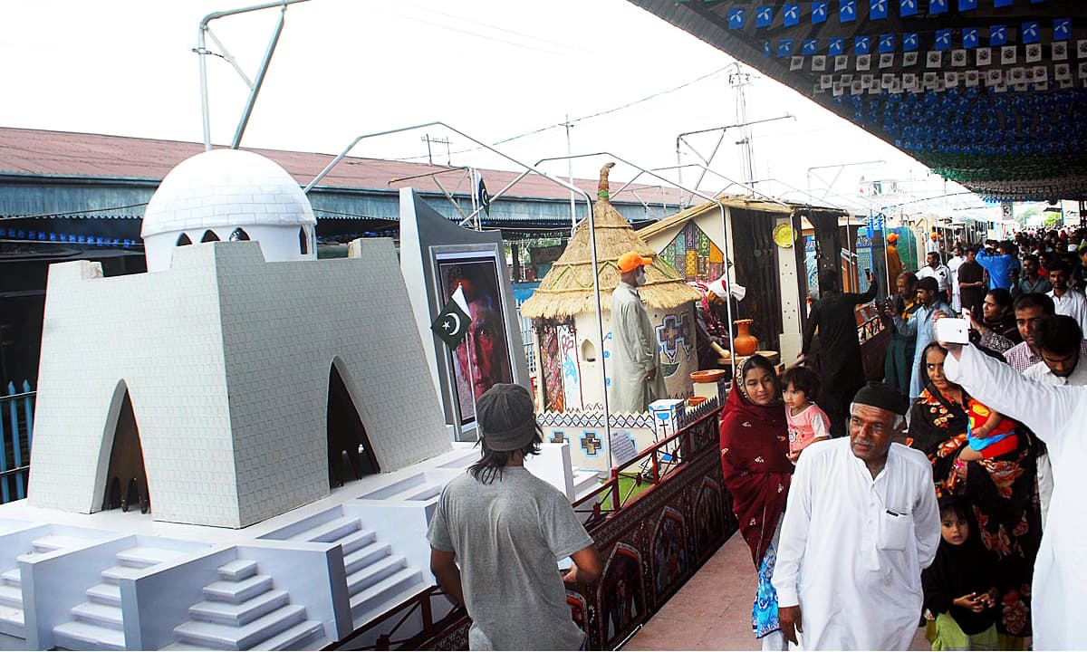 People look at floats of Azadi Train displaying different monuments. Online