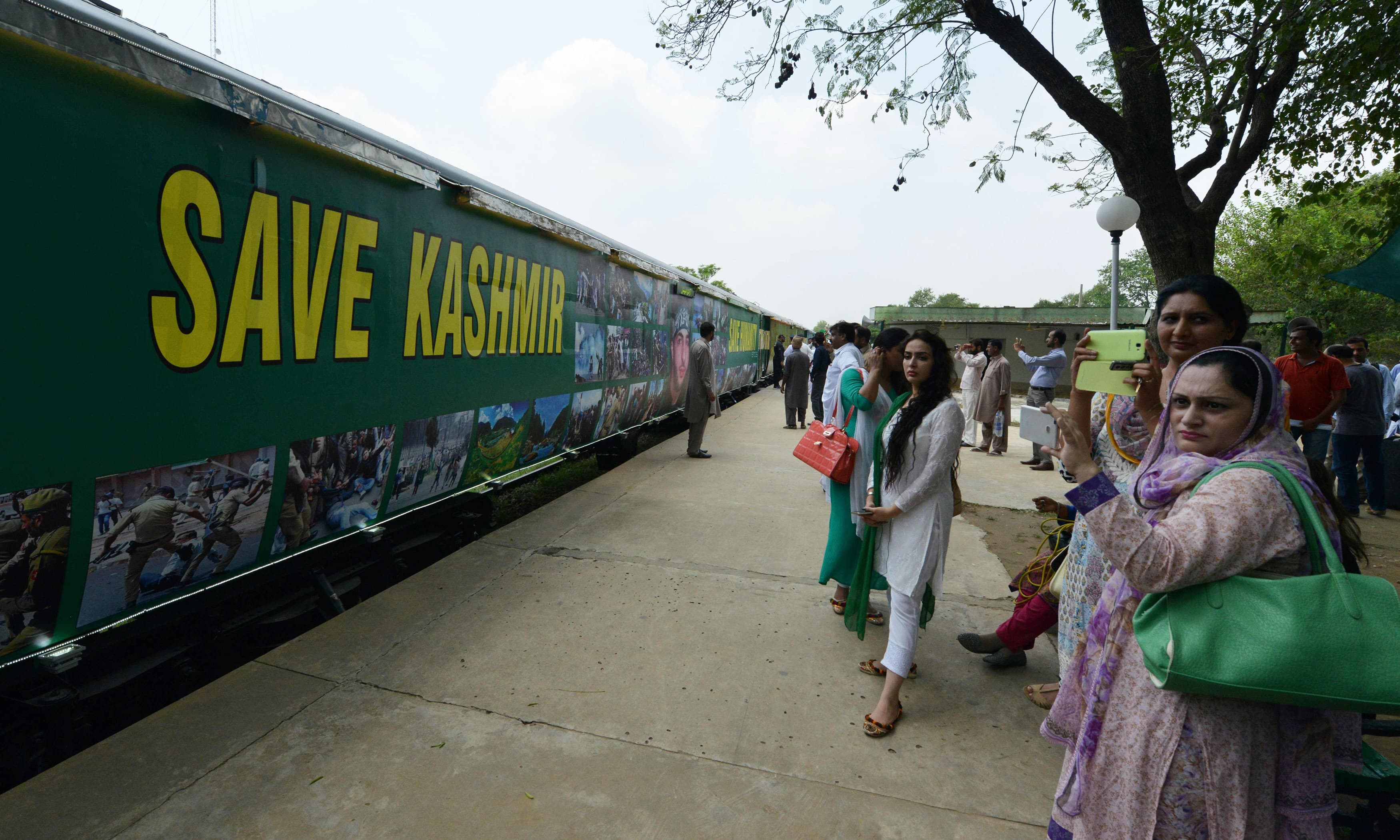 People look as the Azadi Train prepares to start its journey at Margalla Railway Station. —AFP