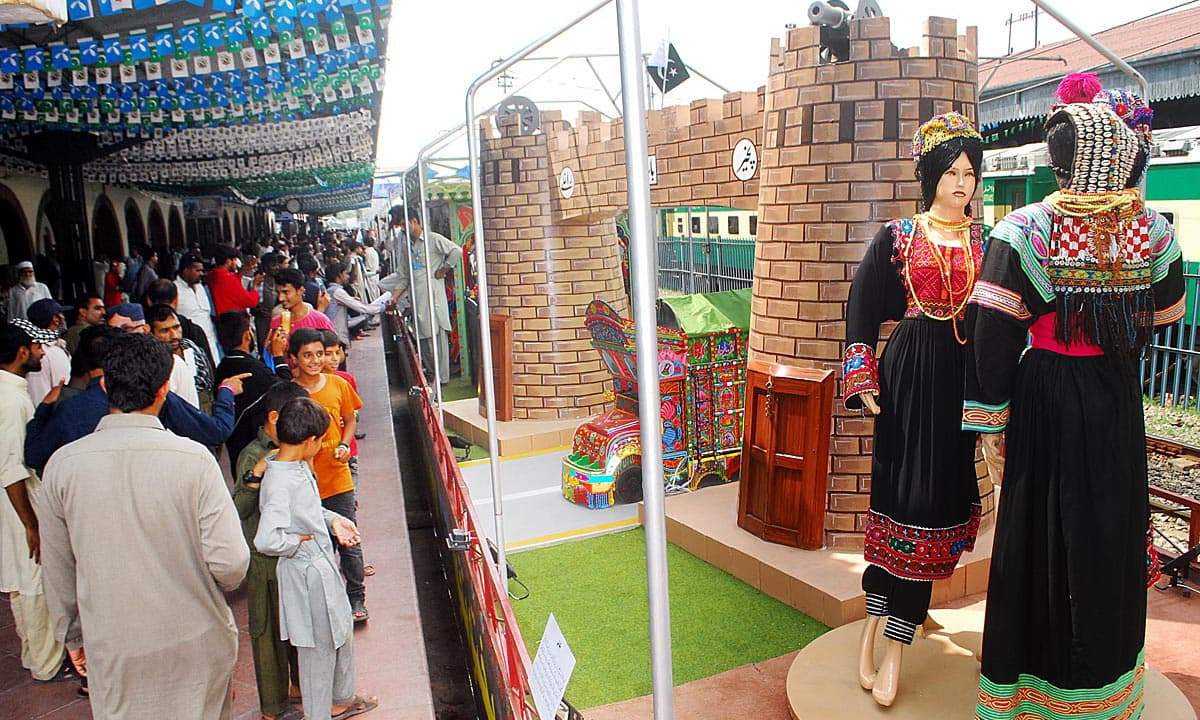 People look at floats of Azadi Train displaying different cultures. Online