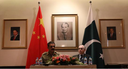 Pakistan's military spokesperson Lieutenant General Asim Saleem Bajwa (L) and Ambassador of Pakistan to China Masood Khalid (R) at a press conference in Beijing on May 17, 2016