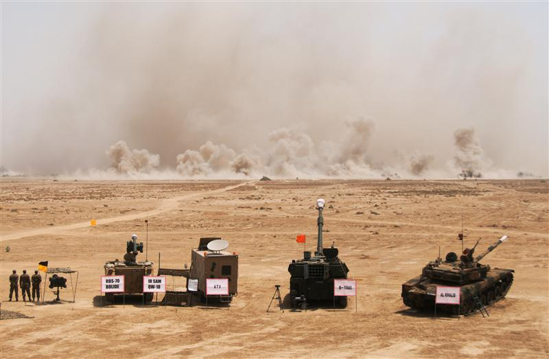 Smoke billows as Pakistani army tanks and gunship helicopters hit their targets during a military exercise in Bahawalpur, in Pakistan's Punjab province, April 18, 2010. Pakistan's army is holding its biggest military exercises