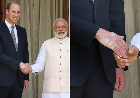 Modi leaves an imprint on British Prince William's hand during his visit to India.–File photo