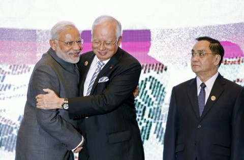 Laos's Prime Minister Thongsing Thammavong, right, watches Modi embrace Malaysia's Prime Minister Najib Razak at the 27th Association of Southeast Asian Nations (ASEAN) Summit in Kuala Lumpur, Malaysia.–File photo