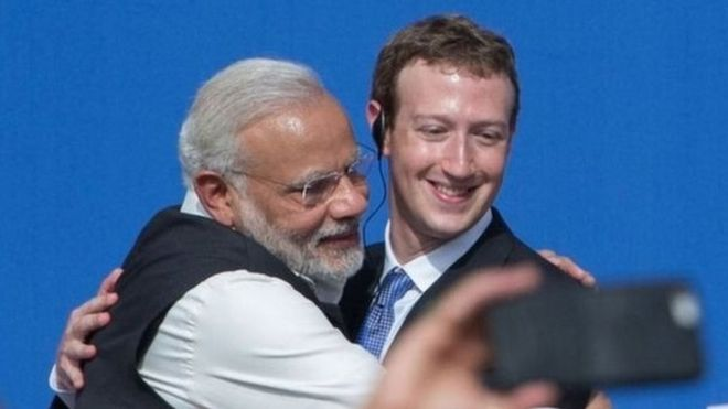 Narendra Modi hugs Facebook founder Mark Zuckerberg.–File photo