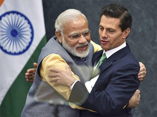 Narendra Modi hugs Mexican President Enrique Peña Nieto.–File photo