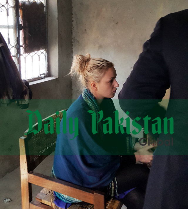 Tereza Hluskova, who was arrested with nine kilograms of heroin at Lahore airport on January 10, at waiting room in city courts.–Staff photo by Nozair Hanif Mirza